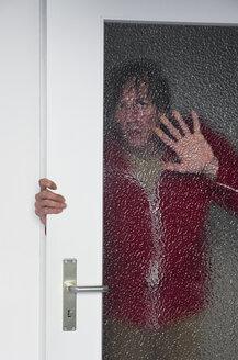 Man looking man opening door - MUF001455