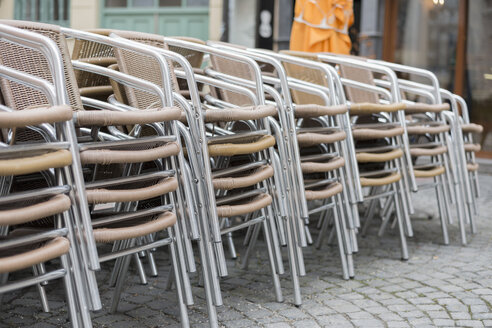 Stacked chairs of a restaurant in pedestrian area - HLF000410