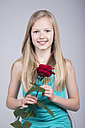 Smiling blond girl holding red rose - VTF000131