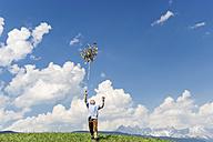 Austria, Salzburg State, Altenmarkt-Zauchensee, teenager throwing Palmbusch up in the air - HHF004777