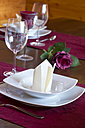 Place setting on festive laid table - SARF000303