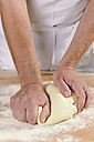 Hands of a man kneading pasta dough for home-made tortelloni - IPF000074