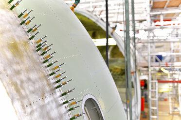 Airplane construction in a hangar, close-up - SCH000028