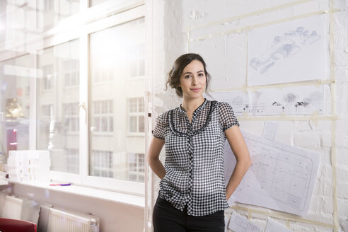 Portrait of young female architect in office - FKF000440