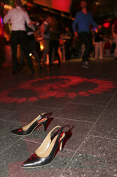 High heels standing on the dance floor of a nightclub - JAT000678