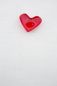 Red heart shaped of cherry jelly on white ground - LVF000797