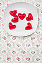 Plate of red hearts shaped of cherry jelly on cloth - LVF000793