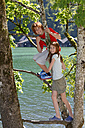 Germany, Upper Bavaria, Berchtesgadener Land, children climbing on a tree in Schoenau at the Koenigssee - LBF000618