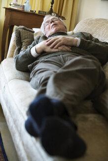 Senior man having midday sleep on sofa - JATF000712