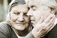 Portrait of senior couple head to head with closed eyes - JATF000717
