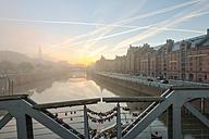 Germany, Hamburg, Zollkanal in the Speicherstadt at sunrise - RJF000008