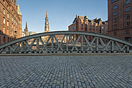 Germany, Hamburg, old warehouse district, Speicherstadt with St Catherine's church at sunrise - RJF000021