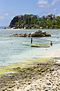 Seychelles, Mahe, L'Islette, boats and two people at beach - WE000036