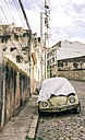 Brazil, Rio de Janeiro, Car on the street covered - AMC000049