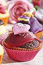 Decorated chocolate muffins in muffin papers - CSF020965