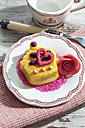 Decorated muffinmarzipan blossom and pink sugar on plate - CSF020992