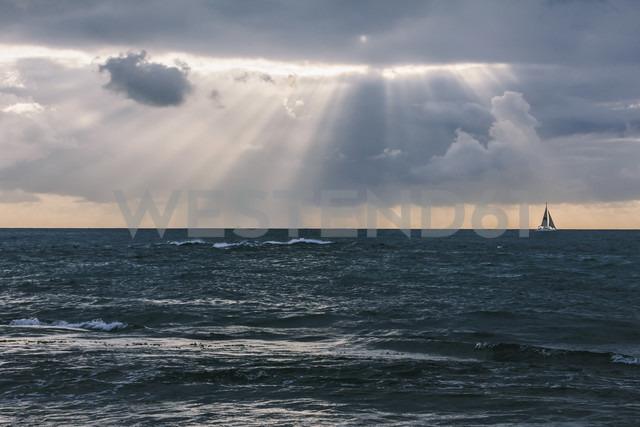 USA, Hawaii, Oahu, Sea at sunset with sailboat - AMCF000053