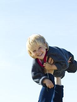 Little girl holding aloft of father - JFEF000279
