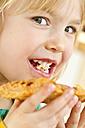 Portrait of little girl eating - JFEF000288
