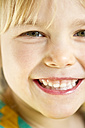 Portrait of little girl smiling, close-up - JFEF000301