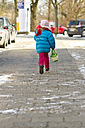 Little girl with bag on pavement - JFEF000309