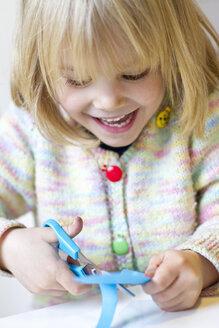Portrait of little girl tinkering - JFEF000312