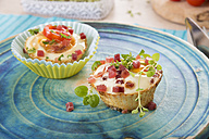 Egg muffin with ham cubes on plate - CSTF000148