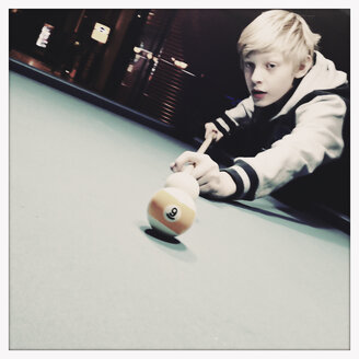 Twelve year old boy playing pool billiard, Hamburg, Germany - SEF000621