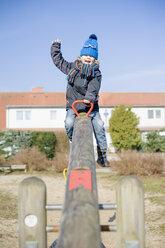 Germany, Mecklenburg-Western Pomerania, Ruegen, happy little boy sitting on rocker - MJF000934