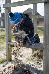Germany, Mecklenburg-Western Pomerania, Ruegen, little boy playing at playground - MJF000937