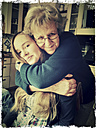 Teenagerinwir embraced by her grandmother, Schirmitz, Bavaria, Germany - SARF000348