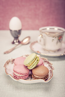 Easter installation with cup of coffee, egg, and bowl of macarons - VTF000155