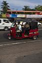 Sri Lanka, Ambagala, Warakapola, Tuk-tuk driving on road - AM001972
