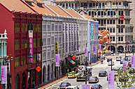 Singapore, Chinatown, view to row of old buildings along a street - THA000140