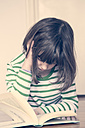 Little girl reading book at home - LVF000848