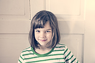 Portrait of smiling little girl at home - LVF000839