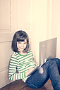Portrait of little girl with laptop at home - LVF000899