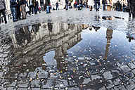 Italy, Rome, Piazza Navona, Church Sant Agnese in Agone reflecting in puddle - EJWF000352