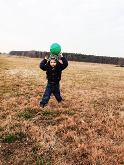 Little boy playing with ball on field in Potsdam, Germany - AFF000031