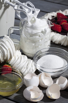 Meringues, measuring cup of beaten egg white and ingredients for meringue - CSF021028