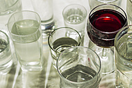 Glass of red wine in between water glasses - CMF000067