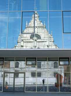 Germany, North Rhine-Westphalia, Aachen, view to glass facade with reflection of St Michael's Church and photographer - HL000429