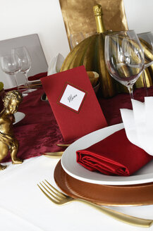 Laid table, red menu card, red and golden place setting - LRF000573