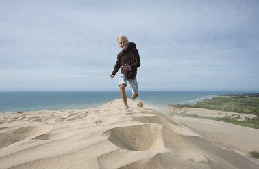 Denmark, Jutland, Rubjerg Knude, running boy on giant sand dune - JBF000085