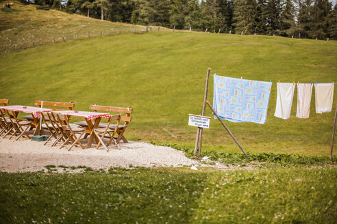 Austria, Gosau, clothesline and empty beer garden - KVF000049
