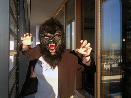 Germany, Berlin, female with gorilla mask - TKF000315