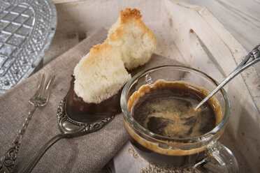 Two coco macaroons on cake server and cup of espresso - CSTF000187
