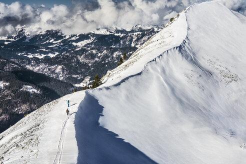 Austria, Vorarlberg, Riezlern, Mountainscape in winter - MUM000059