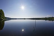Germany, Bavaria, Upper Bavaria, Sachsenkam, Kirchsee lake against the sun - SIEF005192