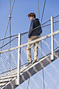Germany, Stuttgart, Teenage boy standing on stairs of Killesberg Tower - WDF002419